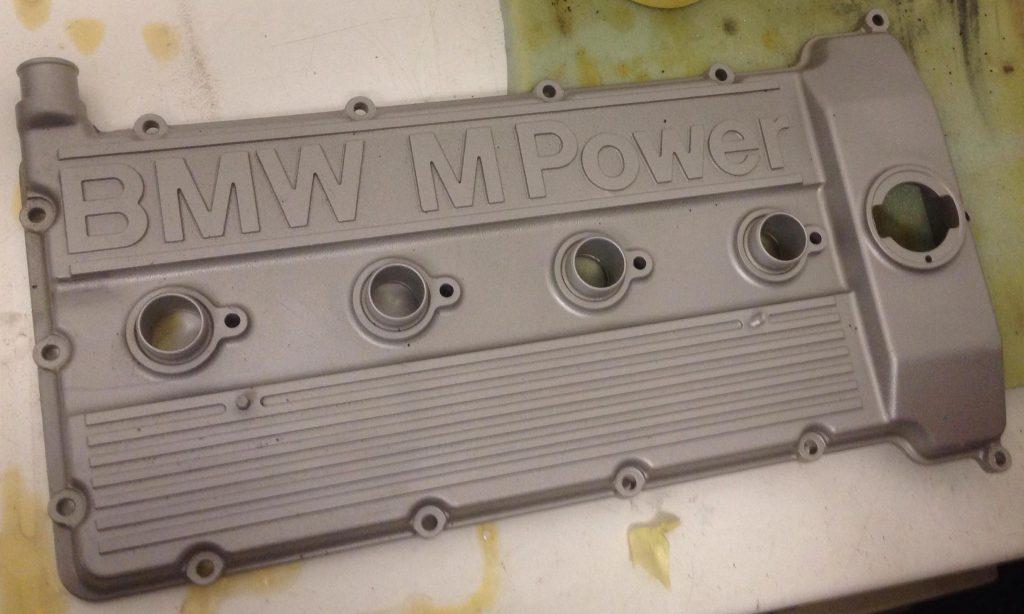 Aqua blasted BMW engine cover
